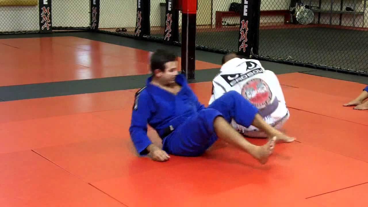 Brazilian Jiu-Jitsu Technique - Spider Guard Sweep and Leg Lock