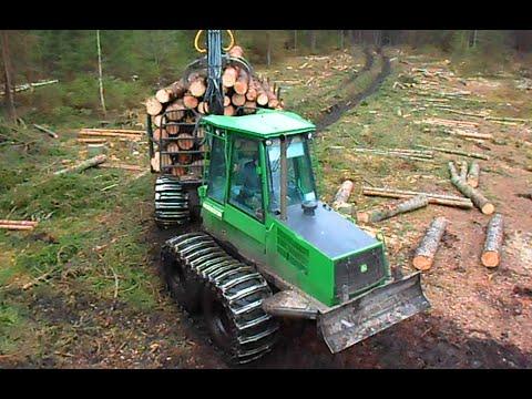 John Deere 1110D logging in wet forest, big load ...