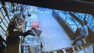 Sword-wielding store owner chases off jewelry store robbers