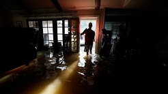 As flooding lingers, Houston begins clean-up