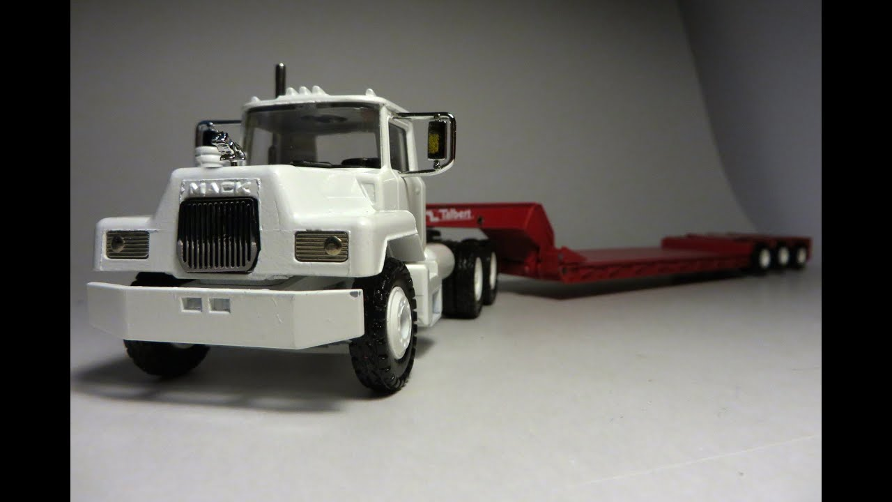 Toy Lowboy together with New 52 Inch Mid Roof Sleeper For Kenworth T680 Now Available For Order also Fontaine Magnitude Lowboy V1 0 also 104685120017 in addition Trailer Tr4 MkII 8258. on mack trucks and lowboy trailer
