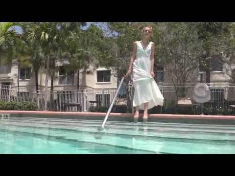 ashley-monroe-enters-the-water-in-a-white-dress