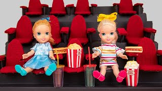 Elsa & Anna at the Movies! Anna makes a big mess and goes on her iphone!