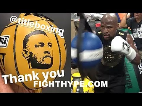 MAYWEATHER GETS MCGREGOR'S FACE PAINTED ON BAG; EAGER TO TAG IT FOR REAL ON FIGHT NIGHT