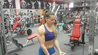 24 year old muscle girl Dolly curling and show her big biceps.