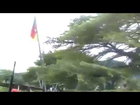 COURAGEOUS Ambazonia YOUTHS CONFRONTED THE MILITARY AT THEIR BASE.  TOOK DOWN CAMEROON FLAG.