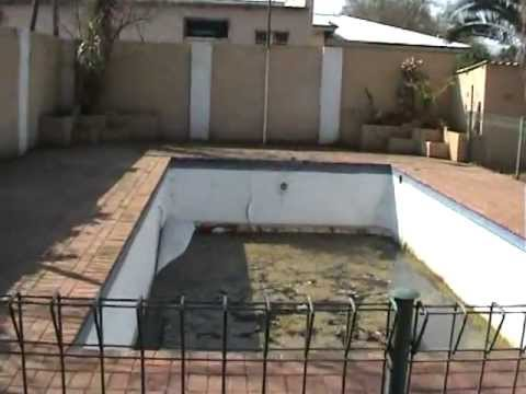 Fixing the pool, Potchefstroom, South Africa