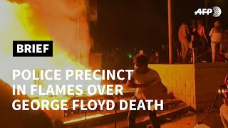 Police precinct in flames in US protest over death of black man | AFP