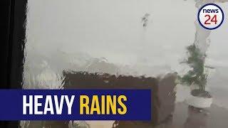 WATCH: 'Hier's 'n vet f*kop!' - Torrential rains carry away Bloubergstrand roof, furniture