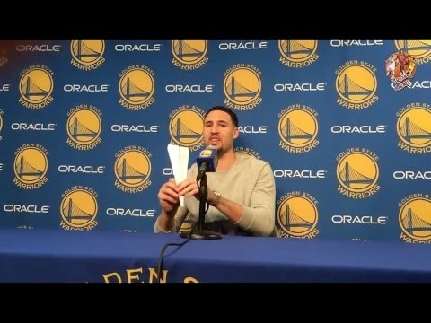 Klay Thompson makes paper Airplane, throws it at the cameraman