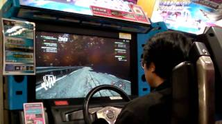 A Japanese business man playing initial D 5 and showing how it