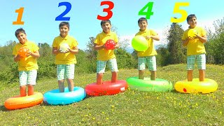 Guka plays with water balloons and learn colors with five little monkeys jumping on the bad song