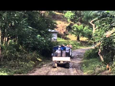 Leaving La Libertad Honduras on a muddy road 11-2013