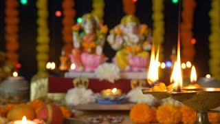 Close up shot of burning oil lamps with bokeh effect in the background - Diwali festival