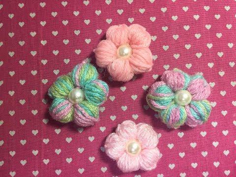 Flor feita de lã com dois Lápis