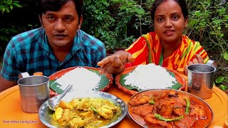 Smiley Couple Eating Delicious Lunch - Rice with Katla Fish Dum Pukht  - Sorse Chicken