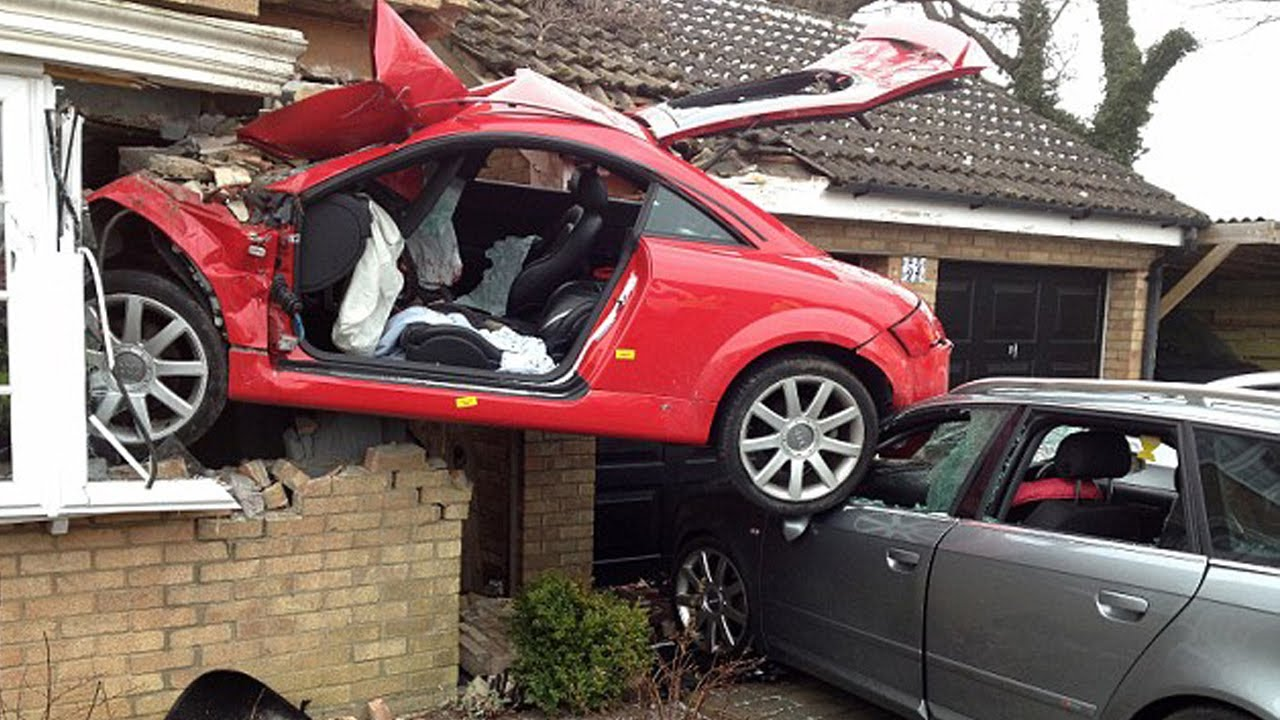 crazy car crash ends up with car in the side of a house youtube