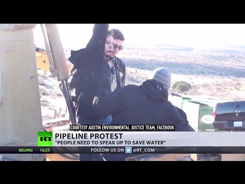 'Big corps are taking over': 16yo pipeline protester arrested after chaining self to bulldozer