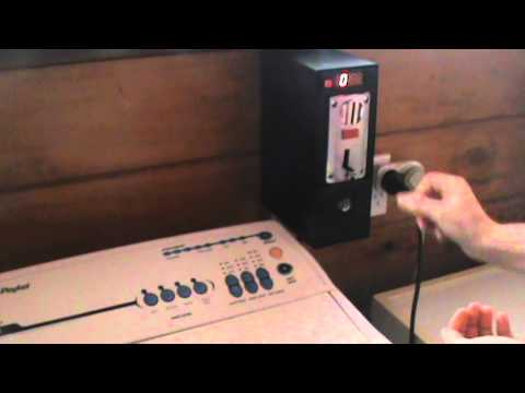 NZ Coin Operated Timer. Shows operation of auto washer with 2x $1.00 coins.