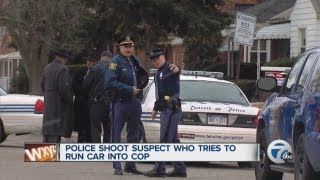 Police shoot suspect who tries to run car into cop