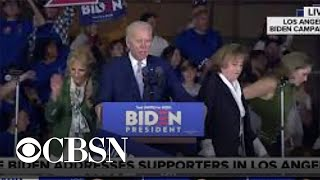 Protesters rush the stage during Biden's Super Tuesday speech