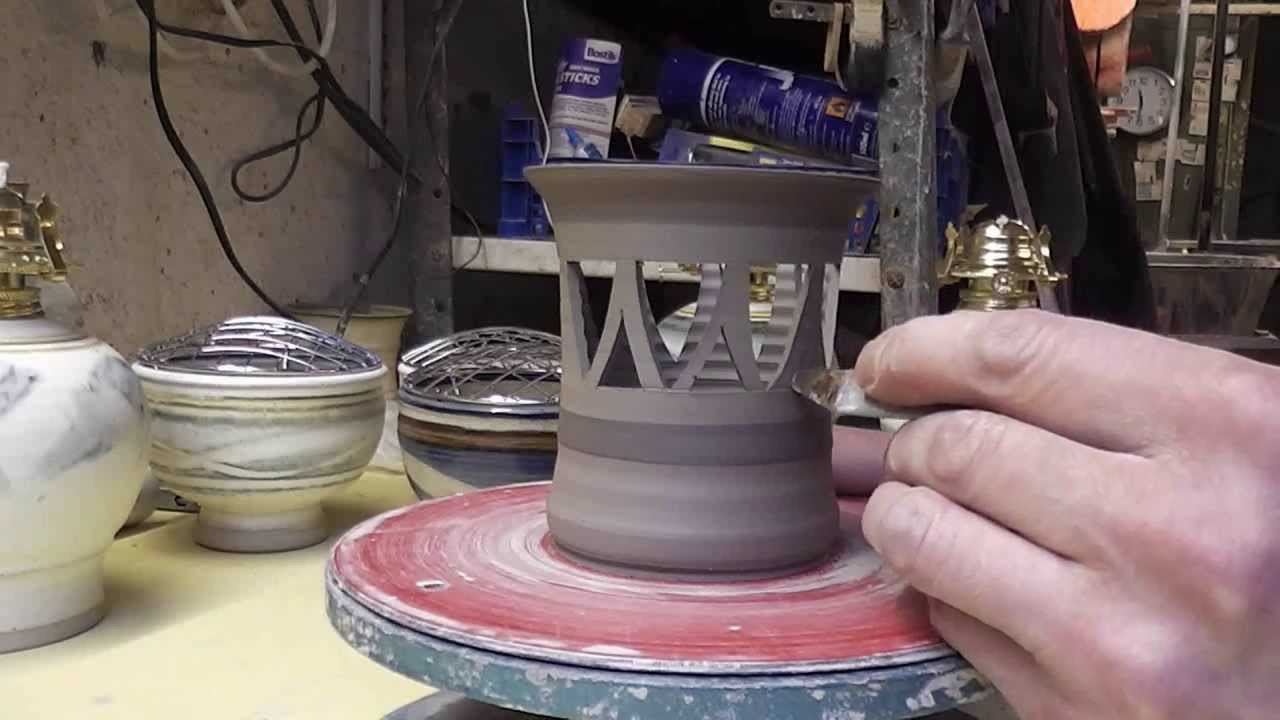 Carving Piercing Some Small Pottery Candle Holders Close