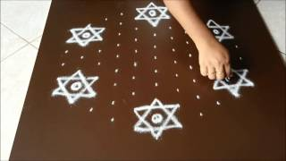 Simple star kolam with 11 dots