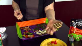 "1 of 2. Jodi prepares easy to make "" fun"" Halloween treats. Check out the second video of Sam' ""gross"" treats too !"