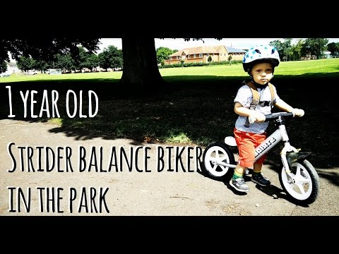 1 year old Strider balance biker in the park (Video)
