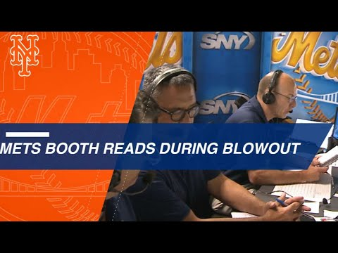 Gary Cohen, Keith Hernandez and Ron Darling read the media guide during a blowout