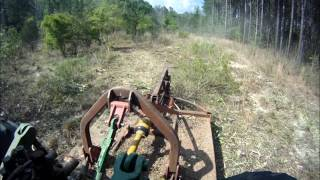 Brown Tree Cutter - Open Back Tree Cutter field clearing.wmv