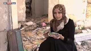 معرض فني على أنقاض منزل مدمر بغزة