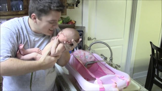 Baby Aubrey poops on Daddy (and Mommy just laughs)