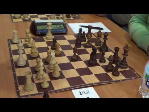 WGM Rogule Laura - GM Sveshnikov Evgeny, Catalan opening 4....dc, Rapid chess