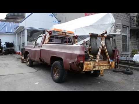 ROUGH GMC TOW TRUCK AT OLD GARAGE