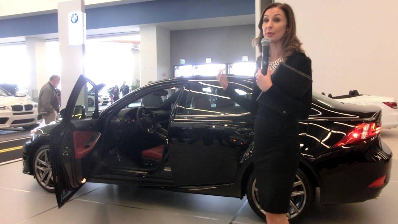 A Girl in black talk about a black Lexus IS 350 F Sport