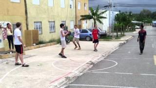 Parker playing basketball in the street (Villa Progressa)