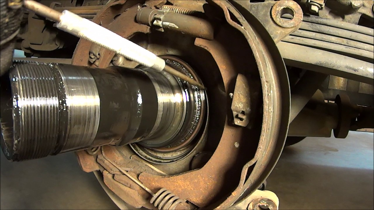 how to change rear seal 2003 gmc