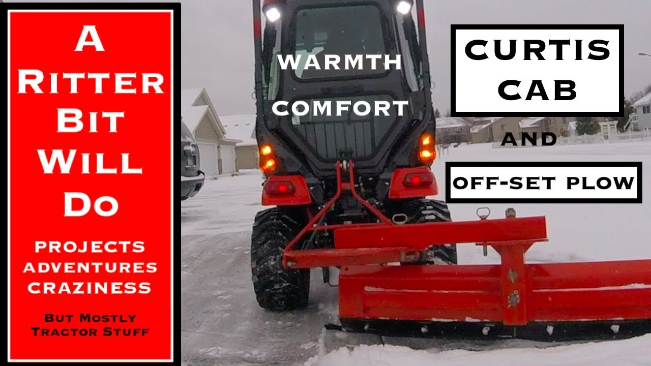 PLOWING SNOW IN A CURTIS CAB (Kubota BX Tractor)
