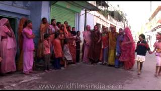 Women singing folk songs and performing traditional Holi dance