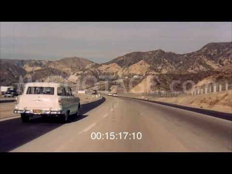1950s POV DRIVING ON VARIOUS TYPES OF ROADS HIGHWAYS Stock Footage HD