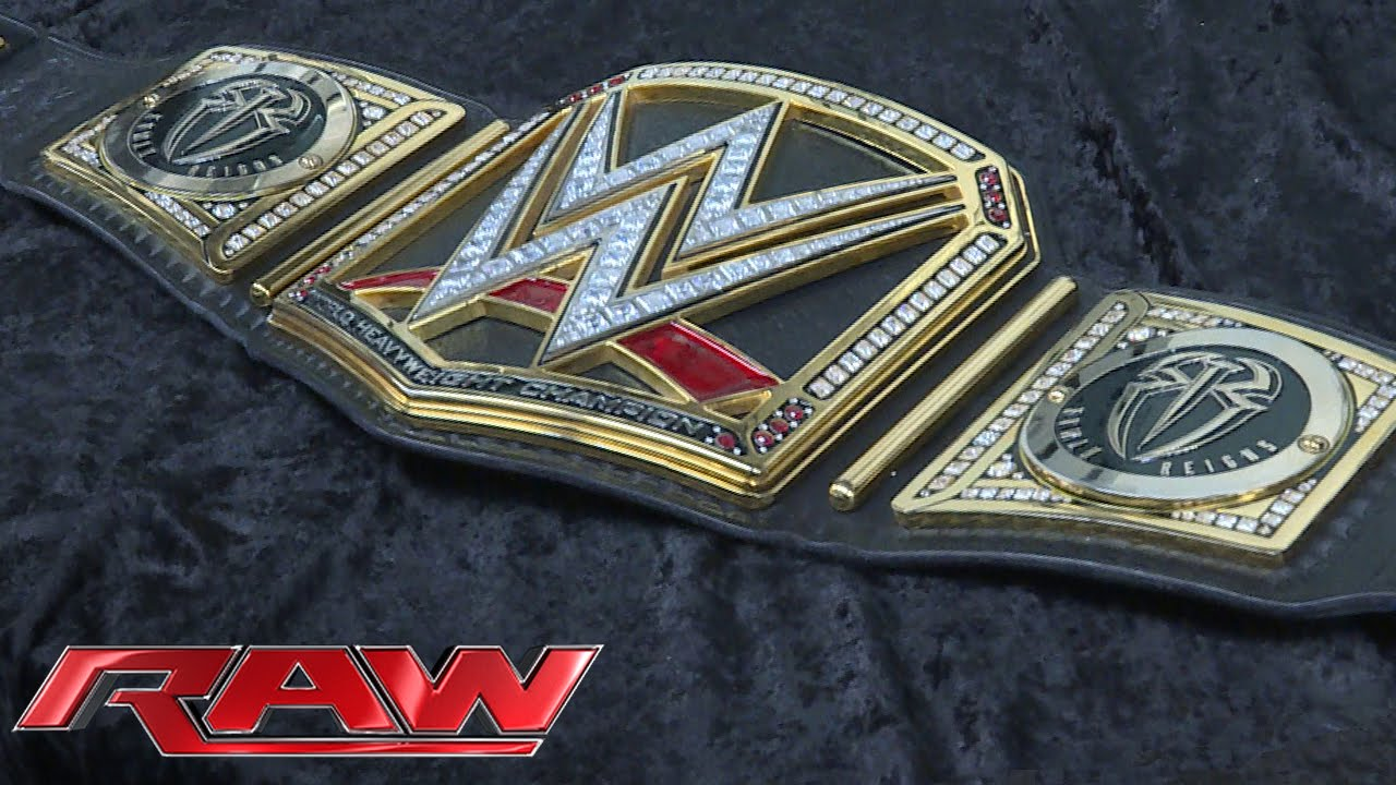 roman reigns receives his customized wwe title plates april 4 2016