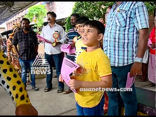 Puli Kali at Thrissur Railway station for the public awareness about railway rules