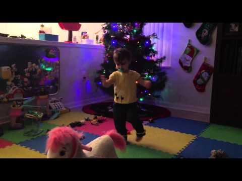 Olivia dancing to musical Christmas ornaments