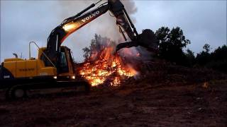 140 volvo excavator pushing up the fire