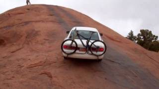 Moab rock crawling in a Crown Victoria - baby lions back slick rock jeep climb
