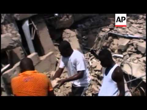 Recently built shopping mall collapses trapping dozens of people