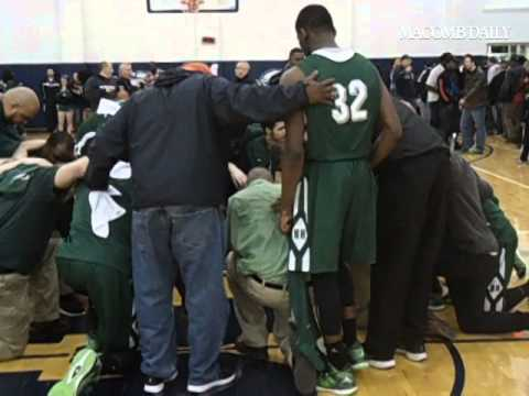 New Haven players and staff huddle after loss to Detroit Henry Ford in Class B quarterfinal at Marys