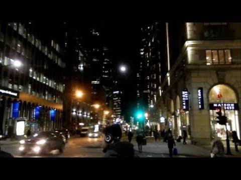 WALKING PEEL STREET IN DOWNTOWN MONTREAL