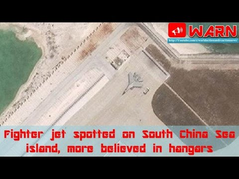 Fighter jet spotted on South China Sea island, more believed in hangars